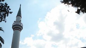 Minaret time lapse with blue sky and white clouds stock footage