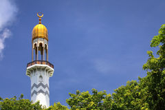 Minaret. Traditional white minaret tower with blue sky Royalty Free Stock Photography