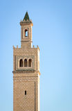 Minaret, Tunisia. Looking up at a traditional minaret tower, a distinctive architectural feature of mosques Stock Images