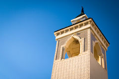 Minaret, Tunisia. Looking up at a traditional minaret tower, a distinctive architectural feature of mosques Royalty Free Stock Photography
