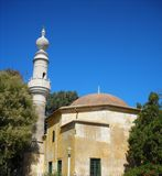 Minaret in Turkey. Probably abandoned temple. Clear blue sky. Sunny day Royalty Free Stock Images