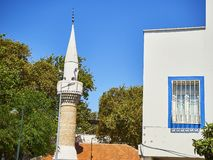 Minaret of Turkkuyusu Cami mosque, view from Turgut Reis street. stock photo