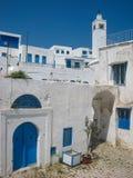 Minaret and blue windows. Sidi Bou Said. Tunisia. Minaret and typical white houses and blue windows. The town was named after sidi Abou Said ibn Khalef ibn Yahia Royalty Free Stock Photo