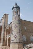 Minaret van madrasa Kukaldosh Stock Afbeeldingen