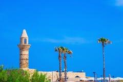 Minaret, walls and palm Caesarea. Stock Images