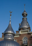 Minarets. Silver minarets on a historic building with golden crescent moons on top Stock Image