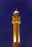 Minarets of Al Fateh Mosque of Bahrain illuminated at blue hours Royalty Free Stock Photo