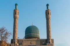 Minarets and blue dome of the cathedral mosque.  royalty free stock photography