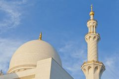 Minarets and domes of the mosque against blue skies. In Abu Dhabi, UAE Royalty Free Stock Photos