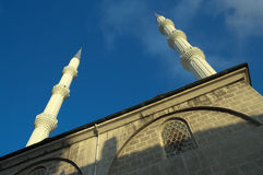 Minarets Of Mosque Against Blue Sky Stock Image