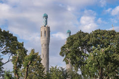 The minarets of the mosque among the trees Royalty Free Stock Images