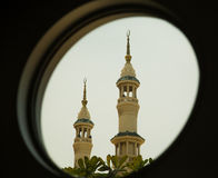 Minarets in the round window Royalty Free Stock Image