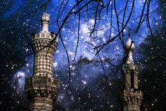 Minarets and stars in the small Magellanic Cloud (Elements of th. Photo-montage of Cairo minarets end infant stars in the small Magellanic Cloud (Elements of Stock Photography