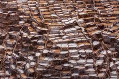 Minas de sal en Maras, valle sagrado, Perú foto de archivo libre de regalías