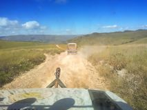 Minas Gerais/Brazil: inside car view, jeeps on dirt road in the mountains