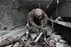 Minatore in una miniera Immagini Stock