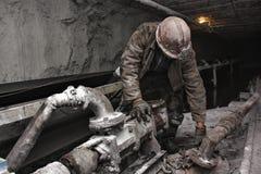 Minatore in una miniera Fotografia Stock