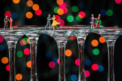 Minature Figures Ballroom Dancing on Wine Glasses Stock Image