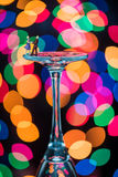 Minature Figures Ballroom Dancing on Wine Glasses Stock Photo