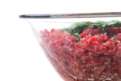 Mince meat. Inside transparent bowl over white Royalty Free Stock Photos