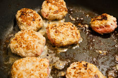 Mince meat balls frying in pan Royalty Free Stock Photo