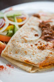 A mince pancake with salad on the side. Fresh beef mince pancake with fresh green salad on the side Stock Images