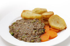 Mince and peas with carrot and saute potatoes Royalty Free Stock Photography