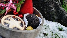 Mince pie with marzipan fruits left in snow and truffle Stock Photo