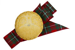 Mince pie on a tartan ribbon. Royalty Free Stock Photography