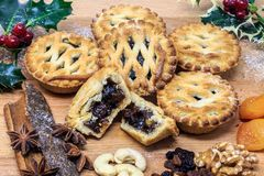 Mince pie with traditional fruit and nuts stock images