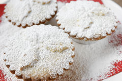 Mince pies. Dusted with icing sugar. Traditional English Christmas dessert. Fruit mincemeat is traditionally made from dried fruit, apple puree, spices, lemon stock images