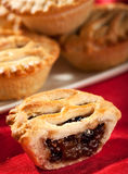 Mince pies. Stacked on a plate shallow depth of field. Focus on front open pie Royalty Free Stock Photos