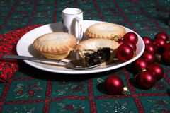 Mince Pies 5. A tasty display of festive Christmas mince pies on a plate with baubles stock image