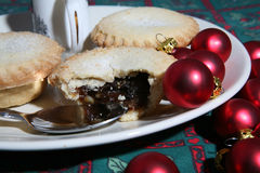Mince Pies 6. A tasty display of festive Christmas moince pies on a plate with baubles royalty free stock photo
