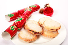 Mince pies with Christmas crackers Royalty Free Stock Photos