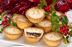 Mince Pies for Christmas with Holly and Berries. Christmas mince pies with holly and berries and christmas decorations stock photo