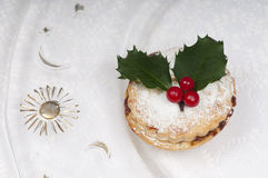 Mince pies on a Christmas plate. Royalty Free Stock Image