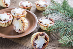 Mince pies with Christmas tree branch Royalty Free Stock Photos