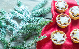 Mince pies with Christmas tree branch Royalty Free Stock Image