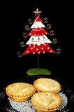 Mince pies and Christmas tree. Royalty Free Stock Images