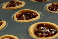 Mince pies with filling in a metal baking tray Stock Image