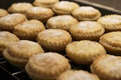 Mince pies fresh homemade by hand close up from above at Christmas on tray royalty free stock image