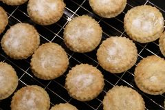 Mince pies fresh homemade by hand close up from above at Christmas on tray stock images