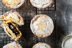 Mince pies, traditional christmas food. Made from all butter shortcrust pastry pies deep filled with plump vine fruits, such as cranberries, clementine Royalty Free Stock Photo