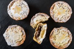 Mince pies, traditional christmas food. Made from all butter shortcrust pastry pies deep filled with plump vine fruits, such as cranberries, clementine Stock Images