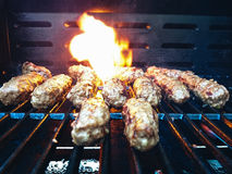 Mince rolls cevapcici on the grill Royalty Free Stock Photo