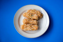 Minced batter fried prawn. Minced batter fried shrimp on dish with blue background Royalty Free Stock Photos