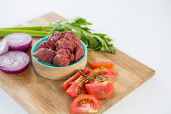 Minced beef and ingredients on wooden tray Royalty Free Stock Photo