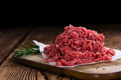 Minced Beef. Minced Meat (Beef) as detailed close-up shot on dark wooden background royalty free stock images