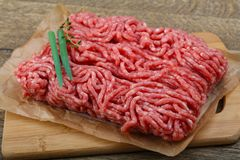 Minced beef. Raw Minced beef with onion ready for cooking Stock Photos